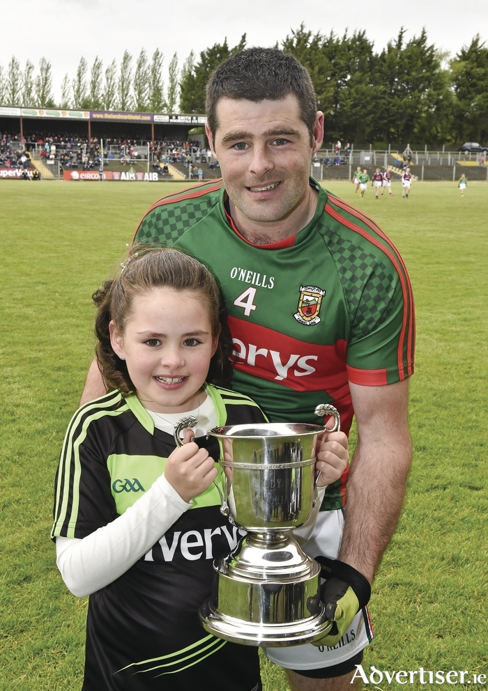 Pride of the Parish: Barry Leonard and his daughter Kathlyn who made her communion last Sunday morning, before her father won the man-of-the match award in the Connacht Junior Final in Carrick-on-Shannon. The communion mass was brought forward so Barry could make both the mass and the game. Photo: Sportsfile