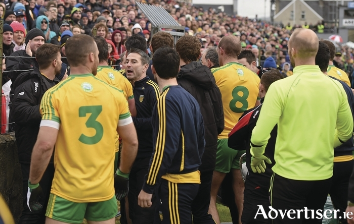 Rough and tumble: The Donegal and Tyrone teams leave the field at half time last weekend. Photo: Sportsfile