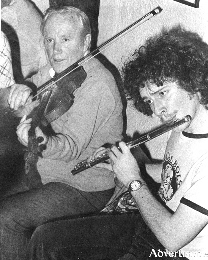 Eddie Moloney and his son Seán pictured in The cottage Bar, Salthill, in 1977.