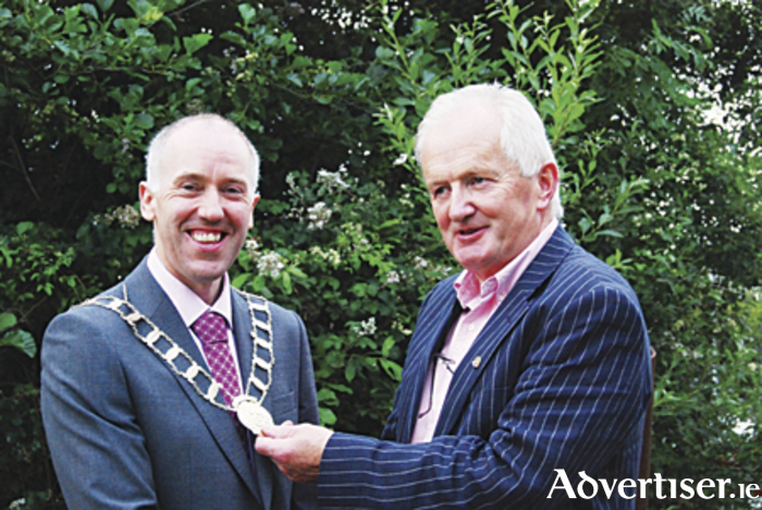 Dermot Neary, who is the 28th president of the Rotary Club of Athlone, received the chain of office from outgoing president Tom Keady.