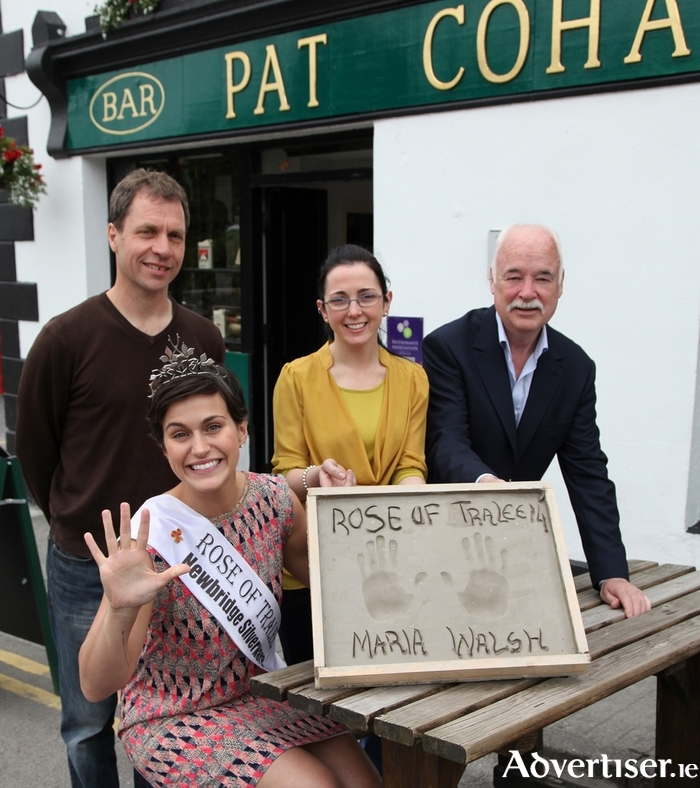 Rose of Tralee Maria Walsh is pictured after giving an impression of her hands which will feature on the Hands of Fame, in Cong village. Also pictured were sculptor of The Quiet Man Statue Mark Rode, with Cong Festival committee members Sharon Naughton and Paddy Rock. Photo:Trish Forde.