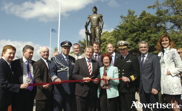 An Taoiseach Enda Kenny with Argentina's Ambassador to Ireland Sylvia Merega, cuts the tape to officially open Foxford's Admiral Brown Promenade. Included are, from left: Oliver Murphy (Admiral Brown Society), Damien Ryan (Cathaoirleach Mayo County Council),  Peter Hynes (chief executive, Mayo County Council), Guillermo Garaces (Argentine Naval Attache), Cllr Neil Cruise, Paul Benson (Mayo County Council director of services), Gus O'Hara (Admiral Brown Society), Rear Admiral Mark Mellett ( Irish Navy), Dep Dara Calleary, and Dep Michelle Mulherin. Photo: Henry Wills.