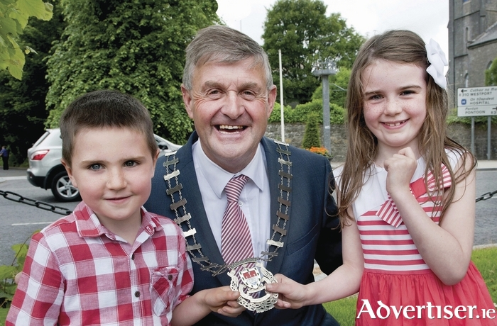 Cllr Michael Holmes, the newly elected Cathaoirleach of Mayo County Council, with his grandchildren Joshua Holmes and Maeve Ganley after his election last Monday. Photo: Tom Campbell.
