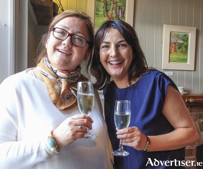 Aine Maguire and Ciara O'Callaghan of Fair City share a celebratory toast at the official opening of The Idle Wall, at The Quay, Westport.