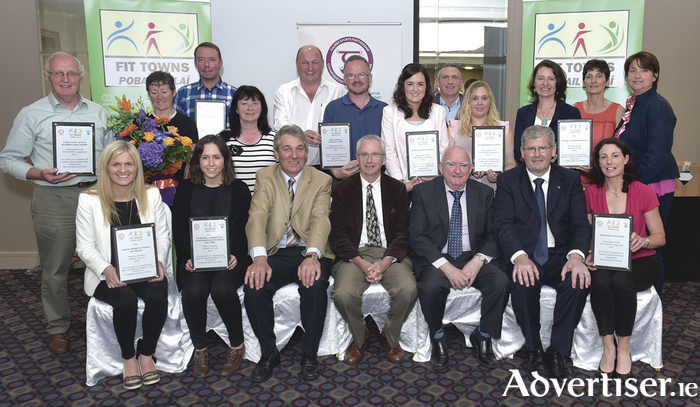 Pictured at the presentation of awards in the Galway Sports Partnership FIT TOWNS initiative in the Harbour hotel, Galway on Monday last were - Back:  Martin Staunton, Eyrecourt Active Retired Ass; Majella Ní Chríochán, Simon Murray, Inishbofin; Noirín Ní Loideán, Club Siúil, An Spideil; Mark Gillen, Craughwell AC; Michael Tobin, Craughwell AC; Cllr Niamh Byrne, Oughterard/Moycullen Fit Towns; Tom Peoples, Moycullen Fit Towns; AN Other, Portumna Fit Towns; Cathy Ní Ghoill, Coiste Aclaíocht, Inis Mór; Joesephine Gardiner, Galway Sports Partnership, Portumna Fit Towns. Front: - Sarah Ní Fhatharta, Coiste Spoirt & Siamsa Inis Meain; Sorcha NÍ Choncra , Comhar Caomhán Teo, Comhairchumann Pobal, Inis Oírr; Michael Curley, Galway Sports Partnership; John Treacy CEO Irish Sports Council;  Declan McDonnell, chairperson Galway Sports Partnership steering group;  Frank Fahy, Galway City Council;  and Sarah Killeen, Fit Towns Portumna.  Absent from the photograph,  Vincent O'Hara, Portumna Fit Towns.
