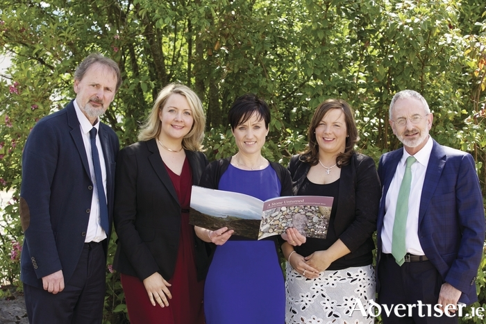Photographed at the launch of the book A Stone Unturned at Lough Lannagh Holiday Village, Castlebar, were, from left: Michael Burke, Family Centre, Castlebar; Claire Riordan and Yvonne McCaffrey, HSE; Mary Malee, Tusla Child and Family Agency; and Michael Murphy, author, psychoanalyst and newscaster, who officially launched the book. Photo: Keith Heneghan.