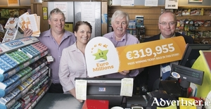 Eugene Carney and his team at The Gem News Costcutter on Bridge Street in Ballyhaunis celebrate the sale of a EuroMillions winning ticket worth €319,955. A lucky Ballyhaunis man collected the prize earlier this month. From left are: Seamus Henry, Anne Carney, and Eugene Carney, from Gems Costcutters, and Pauric Gillespie, National Lottery. Photo: Michael McLaughlin.