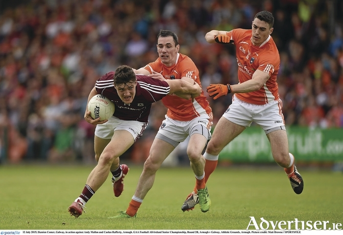 On the burst: Damien Comer is chased by Andy Mallon and Caolan Rafferty of Armagh in the  GAA Football All-Ireland Senior Championship, Round 2B, at the Athletic Grounds, Armagh.