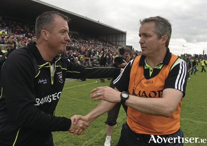 Shake on that: Noel Connelly shakes hands with Sligo manager, Niall Carrew at the end of the Connacht final. Photo:Sportsfile