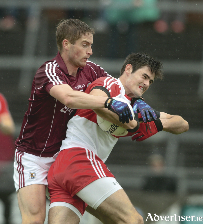 Galway's Gary O'Donnell shows his strength and power against Derry's Christopher McKaigue in action from GAA Football All Ireland senior championship qualifier game at Pearse Stadium on Saturday. 							Photo:- Mike Shaughnessy