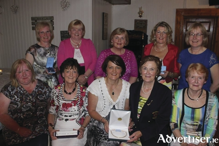 Ladies' winners: The winners at the Balla Lady Captain's prize recently. Back row: Aine MhicSuibhne (fifth), Geraldine Kilgallon (sixth), Helen Byrne (eighth), Mary Gillard (fourth), and Breege Jennings (seventh). Front row: Patricia Conwell (third); Mary B Prendergast (second), Gabrielle Cleshan (first), Patricia Larkin (Lady Captain), and Geraldine O'Malley (gross prize winner).