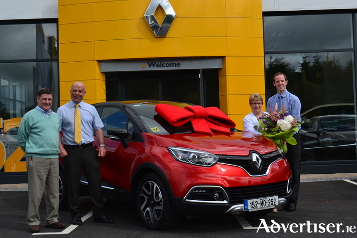 Ann Carter from Westport who picked up the keys to her tenth new Renault from JJ Burke in Ballinrobe is presented with flowers and gift voucher by the garage. Left to right: Peter Carter, Joseph Burke (sales manager), Ann Carter, and Paul McGuinness (sales executive).
