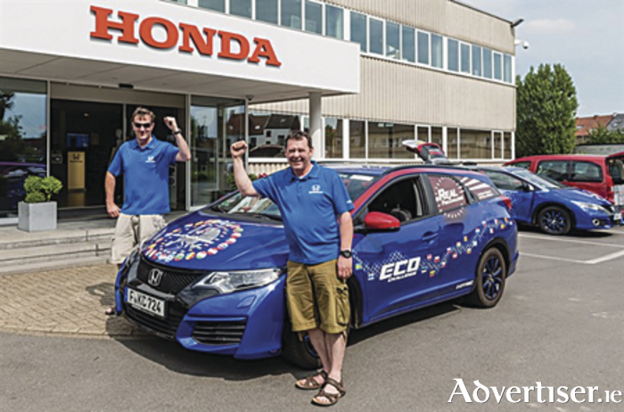 Pictured (L to R) with the record breaking Honda Civic Tourer 1.6 i-DTEC are Fergal McGrath and Julian Warren.