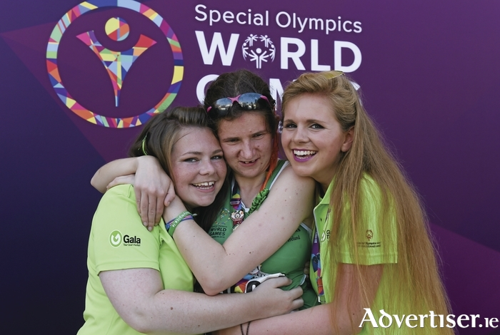 Team Ireland's Aoife Beston from Claremorris (centre) celebrates with her sisters Lorraine and Laura after competing in the 5,000 metre event at the Special Olympics World Summer Games in Los Angeles this week. Photo: Ray McManus/Sportsfile