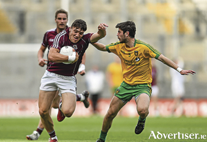 Damien Comer, Galway, in action against Ryan McHugh, Donegal.