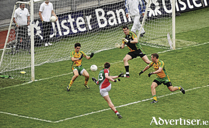 Revenge mission for Donegal — Cillian O'Connor, Mayo, scores his side's fourth goal when Mayo thrashed Donegal in 2013.