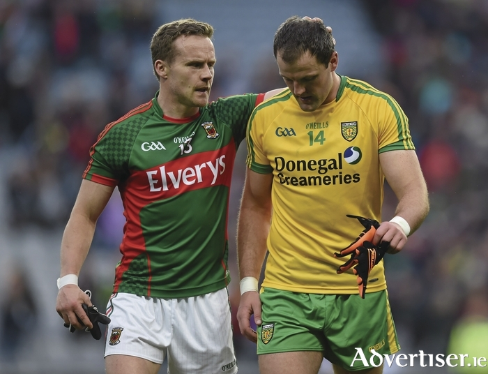 Knowing the pain: Andy Moran consoles Michael Murphy at full time. Photo:Sportsfile
