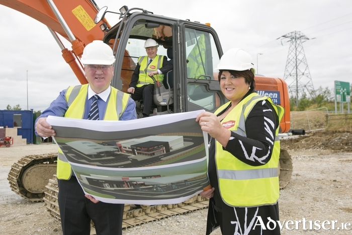 Minister of State at the Department of Transport, Michael Ring, at the launch of the Junction 16 Kiltullagh Plaza development on the M6 with Pat and Una McDonagh. Photo:- Brian Gavin, Press 22