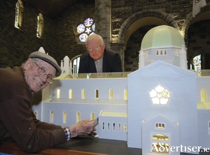 Harry Lawton of Fr Griffin road has created a model of Galway Cathedral to mark the 50th birthday event.  Harry, pictured  here with Fr Peter Rabbitte PP,  worked as a carpenter on the construction of the Cathedral and has been working on the replica for 18 months. Photo:- Mike Shaughnessy