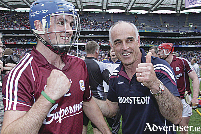 Galway's Johnny Coen and manager Anthony Cunningham are all smiles after Galway's All Ireland Senior Hurling semi-final win at Croke Park on Sunday. 		 				             Photo:-Mike Shaughnessy