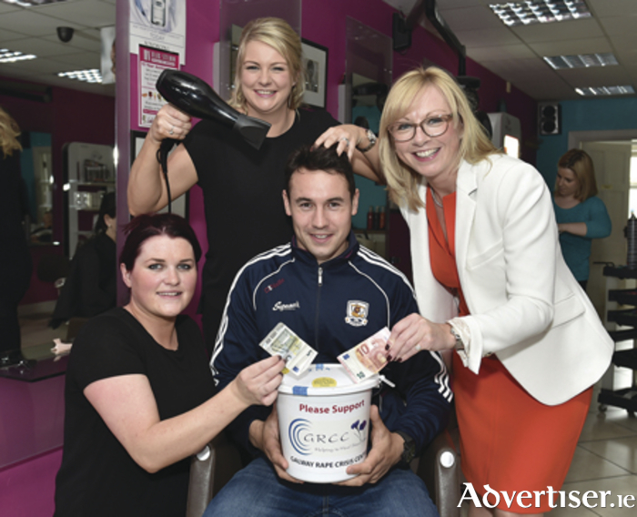 Galway footballer Finnian Hanley, Anita Stankard and Avril Ryder of NV Hair Studio, and Áine Feeney, executive director GRCC at NV Hair Studio, Oranmore, celebrating its tenth anniversary with an all-day fundraising event in aid of the Galway Rape Crisis Centre.  Photo: Joe Travers.