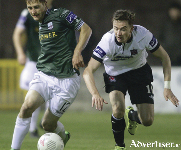 Galwy United goal scorer Jake Keenan and Dundalk's Ronan Finn in action from the FAI Cup game at Eamonn Deacy Park on Friday night.    Photo:-Mike Shaughnessy