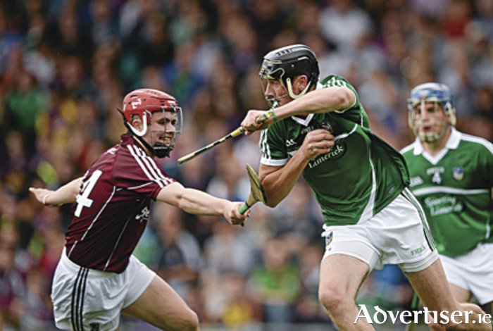 22 August 2015; Diarmuid Byrnes, Limerick, in action against Ronan O'Meara, Galway. Bord Gáis Energy GAA Hurling All Ireland U21 Championship, semi-final, Limerick v Antrim. Semple Stadium, Thurles, Co Tipperary. Picture credit: D?ire Brennan / SPORTSFILE