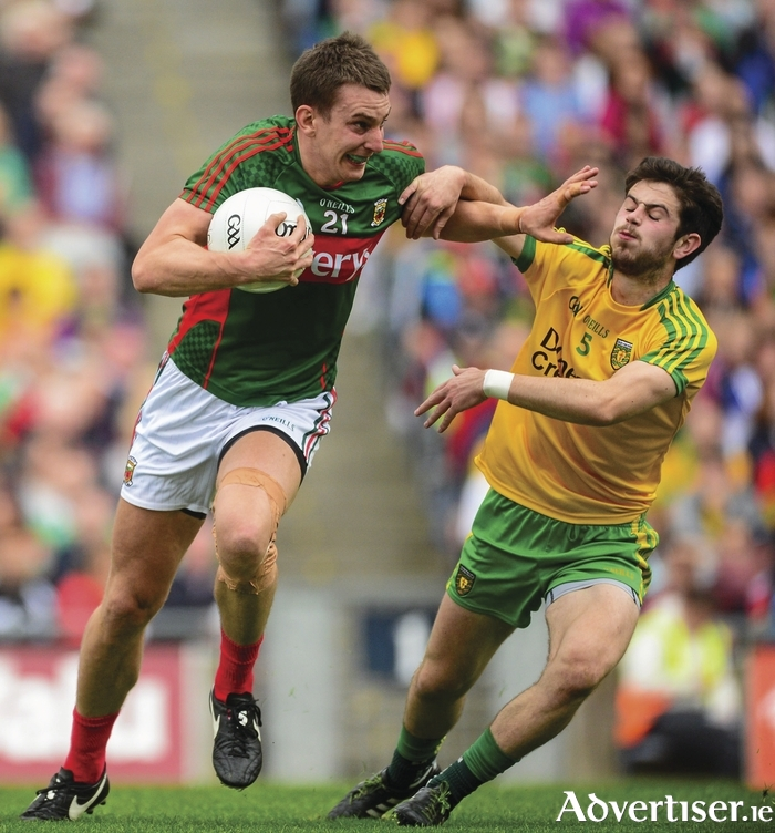 Handing off: Barry Moran will do what he has to for Mayo. Photo: Sportsfile