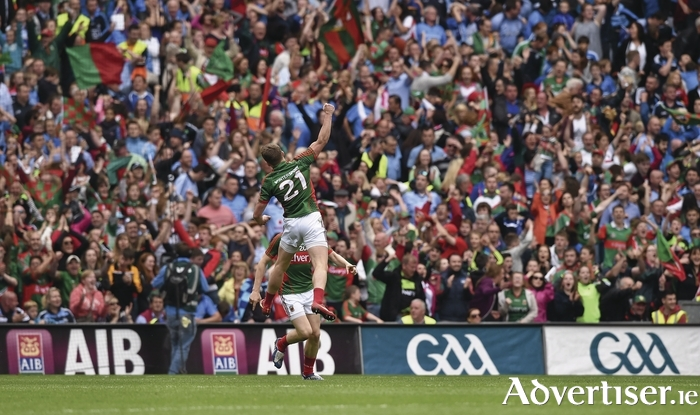 Up and away: Andy Moran celebrates scoring Mayo's leveling point last Sunday. Photo: Sportsfile