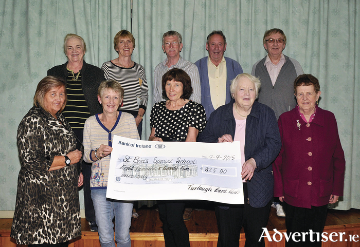 Pictured in Turlough Community Centre, members of the Turlough Card Club who presented a cheque for €825.00 to St Brid's Special School Castlebar. The money was raised by holding a fundraising card game. Front row: Eileen Piggott, Mary Harte (Friends of St Brid's), Cathy Craughwell (principal, St Brid's), Mary Docherty and Maureen Flynn. Back Row: Carmel McSharry, Breta Fitzmaurice (Friends of St Brid's), Pat McHale, Jim Docherty, Michael Mahon. Photo: Ken Wright Photography 2015.