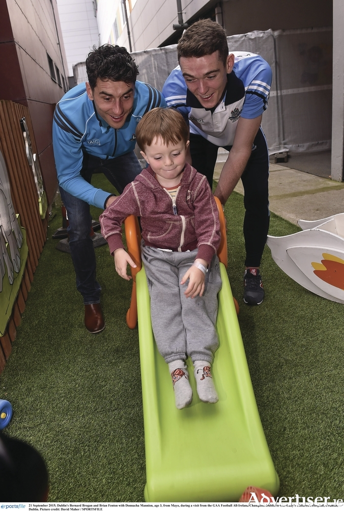 Pushy Dubs: Donnacha Mannion (three) from Mayo gets a push from Dublin's Bernard Brogan and Brian Fenton, during a visit from the GAA Football All-Ireland champions Dublin to Our Lady's Children's Hospital, Crumlin, Dublin. Photo: Sportsfile.