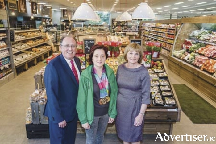 Martin Kelleher, managing director of SuperValu, Special Olympics gold medalist Shauna Stewart, and store owner Mary Croughan, at the opening last week