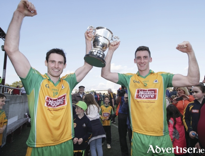 Kieron Molloy and Ciaran McGrath of Corofin with the Frank Cox Cup after winning the Galway Senior Football Championship Final against Mountbellow-Moylough in Tuam Stadium on Sunday.  Photo:- Mike Shaughnessy