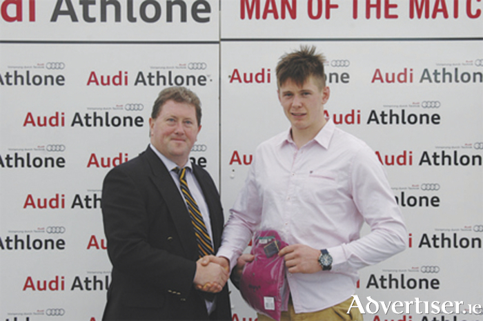 Michael Mannion is presented with the Audi Athlone Man of the Match award by Buccaneers president Joe Browne