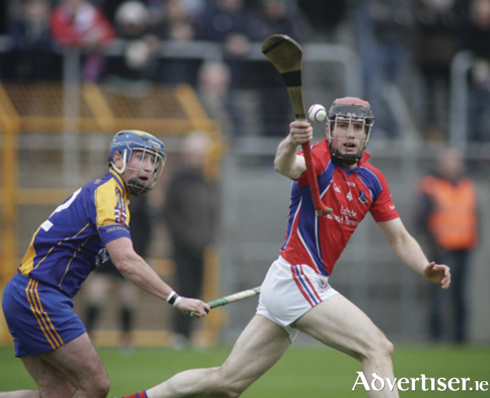 Cathal Burke of St Thomas and Loughrea's Emmet Mahony in action from the Salthill Hotel Galway Senior Hurling Championship quarter-final replay at Kenny Park, Athenry, on Sunday. 						Photo:-Mike Shaughnessy