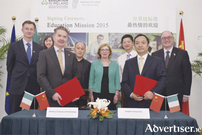 Prof. Ciarán Ó Catháin, president of AIT, pictured with Prof. Li Qiang, president of Jianghan University. Also pictured is Jan O'Sullivan TD, Minister for Education and Skills.