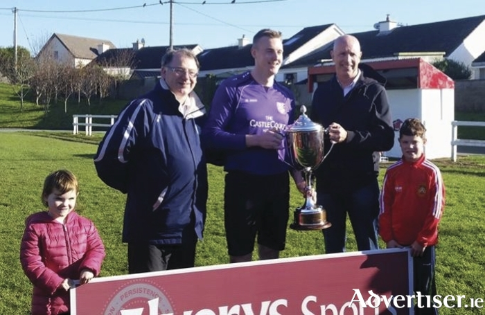 Patrick Rowland the CEO of Elverys Sports presenting the Super League Trophy to Gary Cunningham of Westport United.