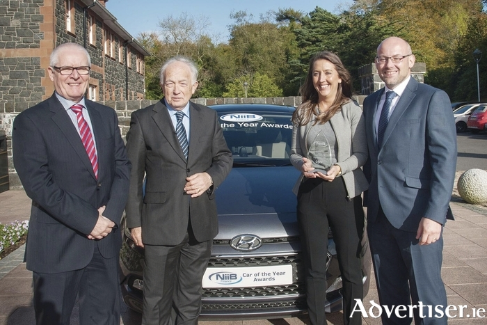 Pictured (L-R) at the presentation of the Northern Ireland Car of the Year 2016 were Terry McLean, regional manager Hyundai UK; Jim McCauley, chairman Ulster Motor Writers' Association; Natasha Waddington, head of press and PR, Hyundai UK; and James Dempster, regional manager NIIB Finance.