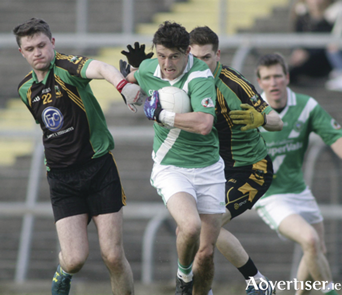 Moycullen's Conor Bohan brakes away from Ml Glavey's Seamus Burke and Darren O'Malley in action from the Connacht GAA Intermediate Club Football championship semi-final at Hyde Park, Roscommon on Sunday. Photo:-Mike Shaughnessy
