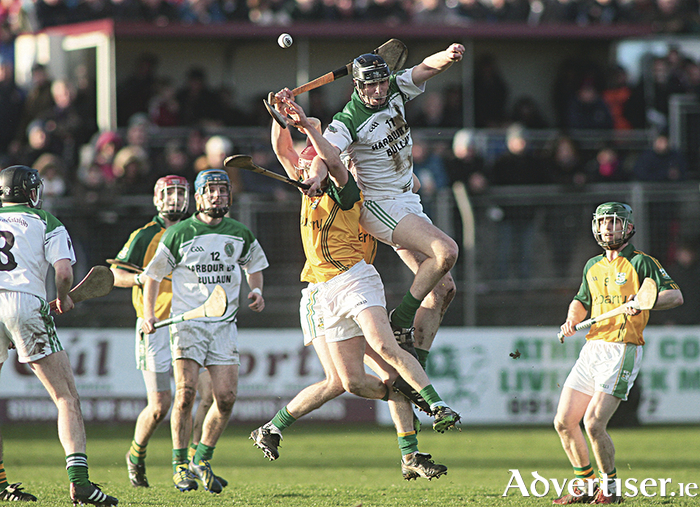 Joseph Cooney (right) Sarsfields and Niall Healy Craughwell.  Photo:- Mike Shaughnessy