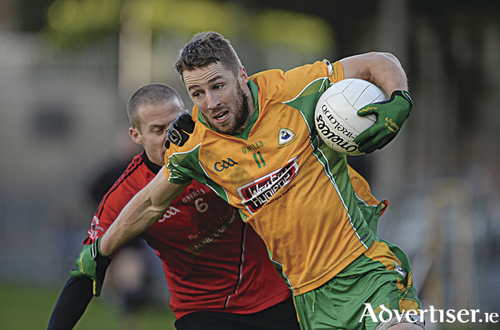 Corofin's Michael Lundy in action on Sunday