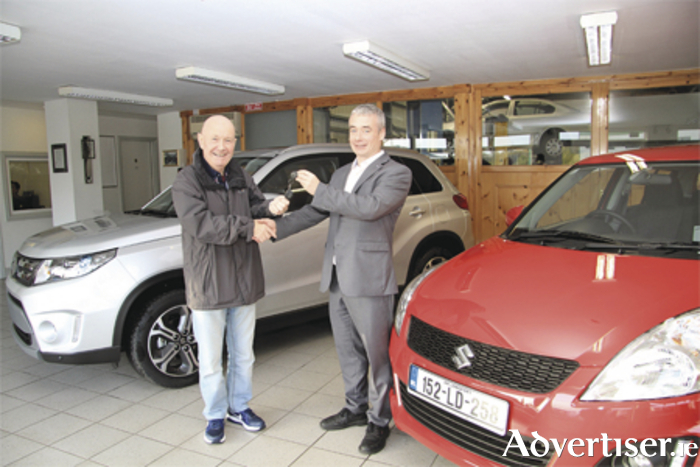 Edward O'Reilly collecting the first new Suzuli Swift sold by Glen McGrath at Michael Shaw Car Sales, the new Suzuki dealer for the Midlands. Photo: Michelle Ghee