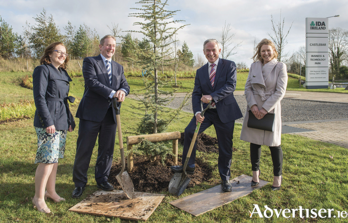An Taoiseach Enda Kenny and Minister Richard Bruton at a tree planting ceremony at the IDA site on the Breaffy Road, Castlebar, where plans for a new IDA development are in place. Also pictured are Ita Lynn (IDA) and Sarah O'Connell (IDA). Photo: Michael McLaughlin.