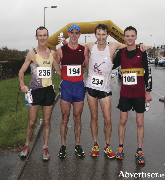 Winners at the Hollymount fiftieth Annual 10k Road Race were, left to right: Gerry Ryan (fourth, Croaghwell AC), Jason Broderick (Craughwell AC), Matt Bidwell (first, Galway City Harriers), Lewis Rodgers (Loftus and Whitby Club, Yorkshire). Photo:Trish Forde.