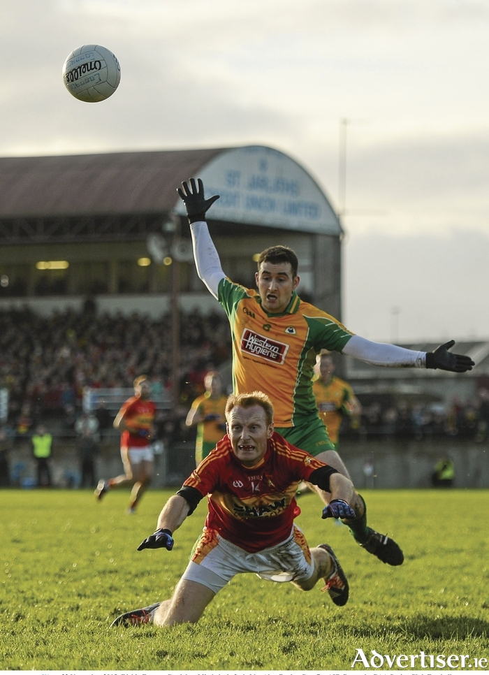 Man and ball: Richie Feeney and Alan Burke go for the ball in Tuam on Sunday. Photo: Sportsfile