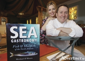 Michael O'Meara of Oscar's Bistro with his wife Sinead and his book Sea Gastronomy. Photo:- Mike Shaughnessy
