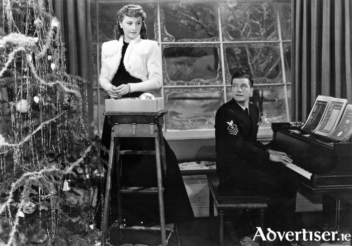 Barbara Stanwyck and Dennis Morgan in Christmas In Connecticut.
