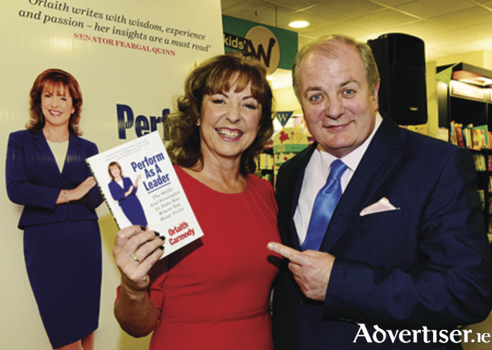 Orlaith Carmody, author of 'Perform as a Leader' pictured with her husband and business partner Gavin Duffy, well-known personality of RTE's Dragon's Den, who will be in Eason's of Shop Street on Wednesday December 18 from 12.30pm signing her new book.
