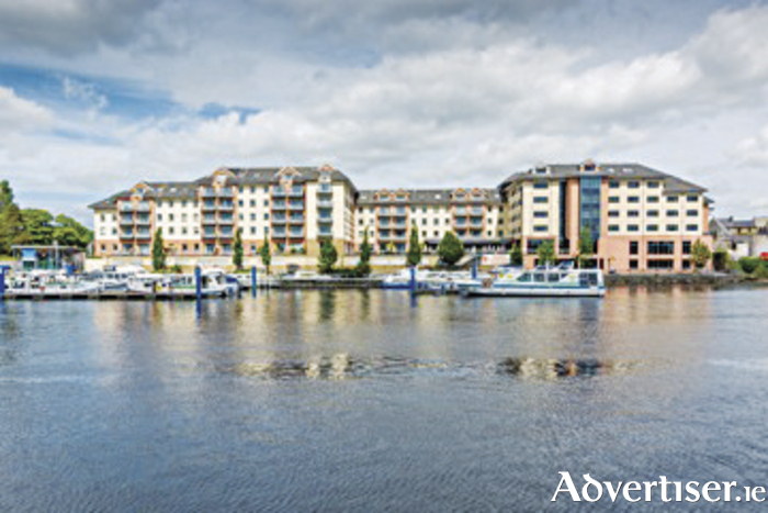 Silver Quay apartments and the Radisson Blu Hotel viewed from across the Shannon