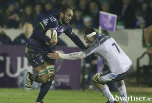 (Above) Connacht's George Naoupu leads the charge against Newcastle Falcons at the Sportsground on Friday night, and (right) Man of the match: Outhalf Jack Carty, who kicked 21 points in Connacht's 25 -10 win in the European Rugby Challenge Cup . Photos:-Mike Shaughnessy